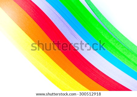 Rainbow colored paper quilling laid in waves isolated on white background