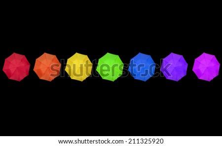 rainbow colored umbrellas on black - stock photo