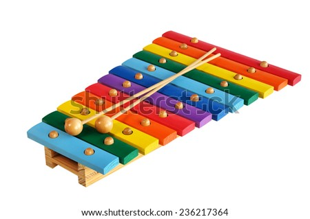 Rainbow colored wooden toy xylophone against white background - stock photo