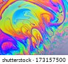 Rainbow colors created by soap, bubble, or oil makes can use background  - stock photo