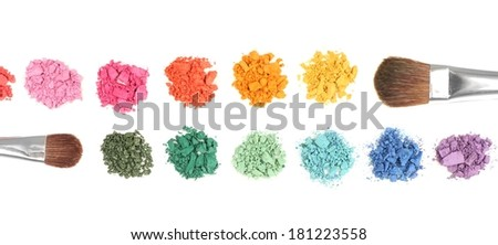 Rainbow crushed eyeshadow and professional make-up brush isolated on white
