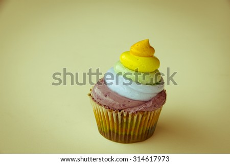Rainbow cupcake on a white background