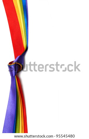 rainbow flag background made of slim stripes in knot - stock photo