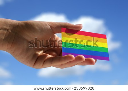 Rainbow flag on small visiting card - stock photo