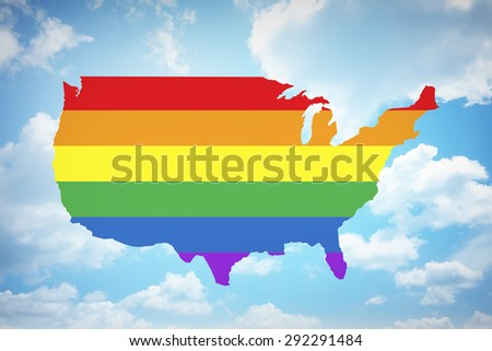 Rainbow flag on United states of america with blue sky background. Gay marriage is legal nationwide - stock photo