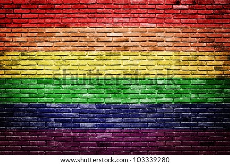 Rainbow flag painted on old brick wall texture background - stock photo