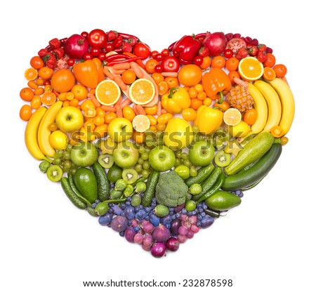 Rainbow heart of fruits and vegetables - stock photo