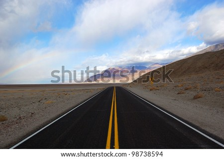 Rainbow in end of the road in Death Valley National Park, California, USA - stock photo