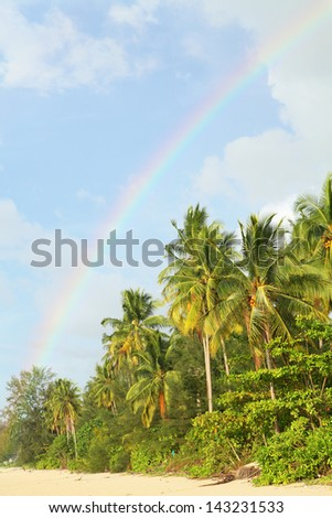Rainbow in evening at the beach of Khoa Lak Thailand