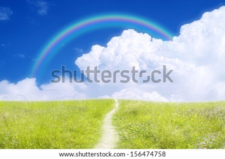 Rainbow in sky - stock photo