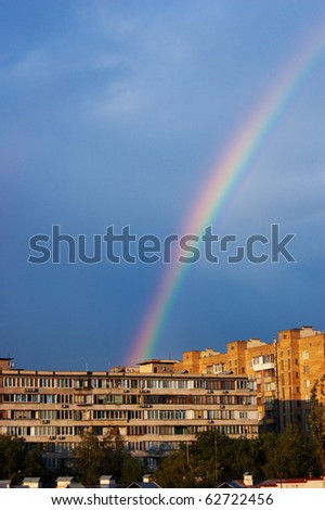 rainbow in the city on summer day - stock photo