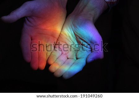 rainbow in the hands - stock photo