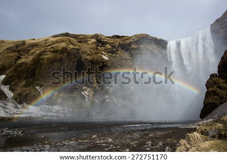 Rainbow in the mist of a waterfall in Iceland