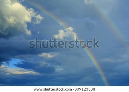 Rainbow in the sky - stock photo