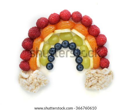 Rainbow made out of fruit - stock photo