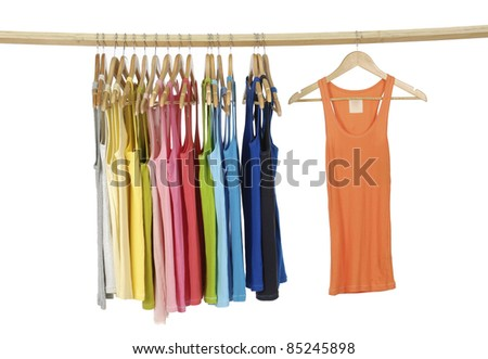 rainbow many Long colorful shirt hanging on wooden hangers - stock photo