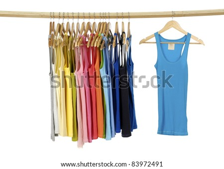 rainbow many peignoir hanging on wooden hangers - stock photo