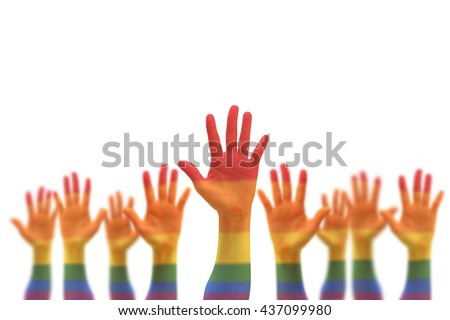 Rainbow multi-color flag pattern on blur many people human hands raising upward isolated on white background (clipping path) LGBT equal rights movement: Equality concept campaign conceptual idea  - stock photo