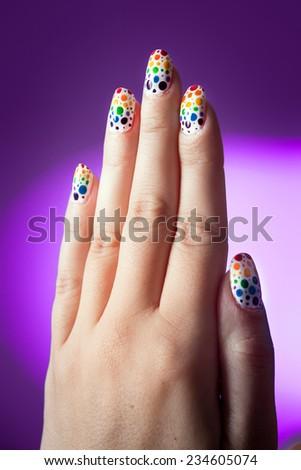 Rainbow nail art polish - stock photo