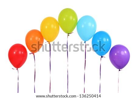 Rainbow of balloons isolated on white - stock photo