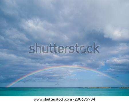 Rainbow on tropical sky - stock photo