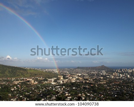 Rainbow over Honolulu with Diamond Head in the distance on Oahu. - stock photo