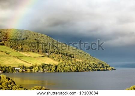 rainbow over Loch Ness lake, Scotland - stock photo