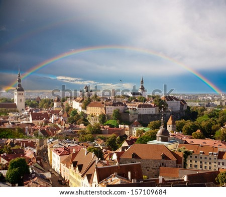 Rainbow over mediaeval city of old Tallinn - stock photo