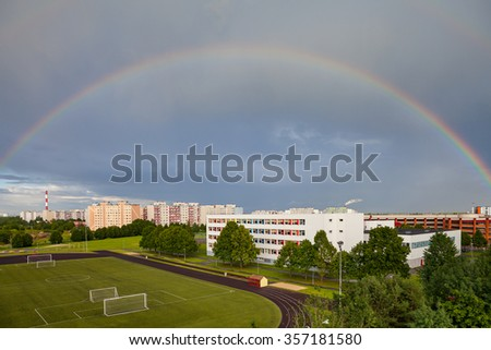 Rainbow over residental part of Tallinn city, Estonia