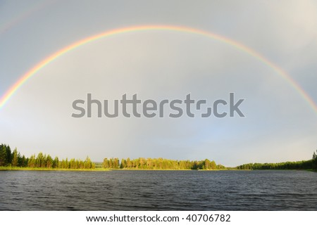 Rainbow over the lake after the rain