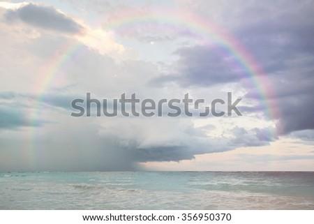 Rainbow over the ocean - stock photo