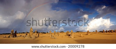 Rainbow over the Pinnacles Desert -  Numbung National Park, Western Australia - stock photo