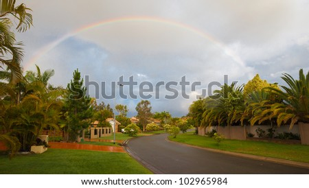 Rainbow over the street, Gold Coast, Australia - stock photo
