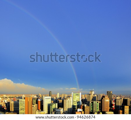 Rainbow over the Umeda District in Osaka, Japan. - stock photo