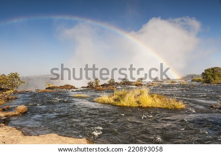 Rainbow Over Victoria Falls, Africa - stock photo