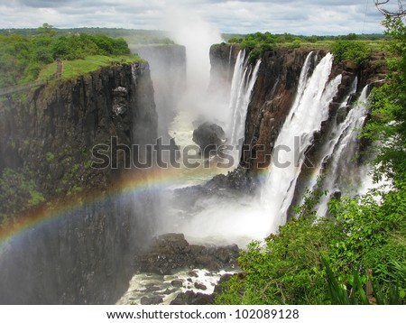 Rainbow over Victoria Falls on Zambezi River, border of Zambia and Zimbabwe
