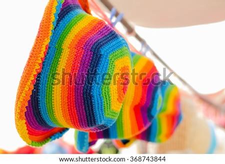 Rainbow rasta hat . Homemade knitted product. - stock photo