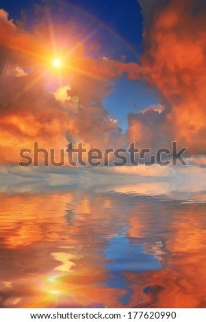 Rainbow reflection in the sea at sunset - stock photo