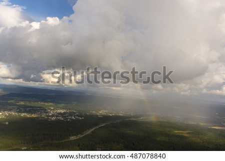 Rainbow seen from the plane on Oslo in Norway