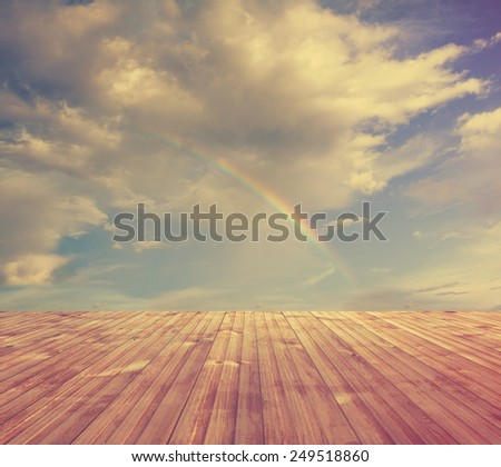 rainbow, sunset sky and wooden floor, background, retro film filtered, instagram style  - stock photo