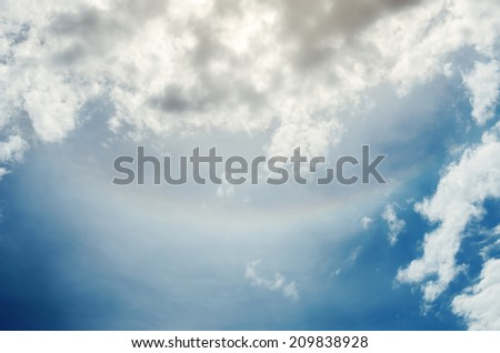 rainbow upside down in cloudy sky. Circumzenithal arc - stock photo