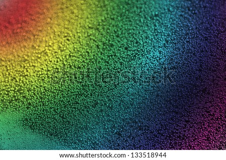 rainbow with raindrops on the glass - stock photo