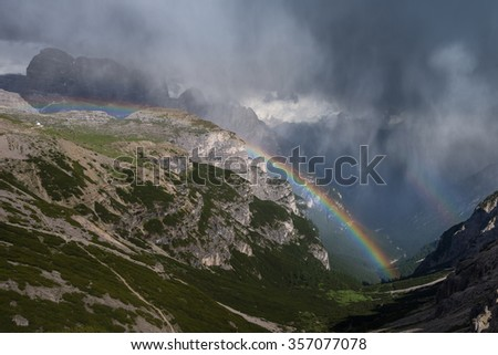 Rainbows appear after short raining in Rifugio Auronzo, Dolomites