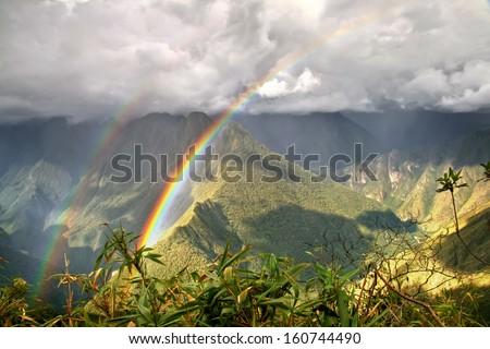 Rainbows in the mountains near Machu Picchu, Cusco, Peru - stock photo