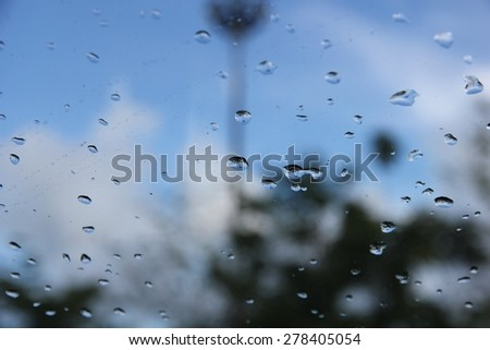 Raindrop on car windshield - stock photo