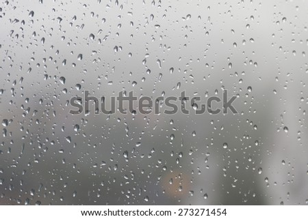 Raindrop, water drops on a glass surface of window. - stock photo