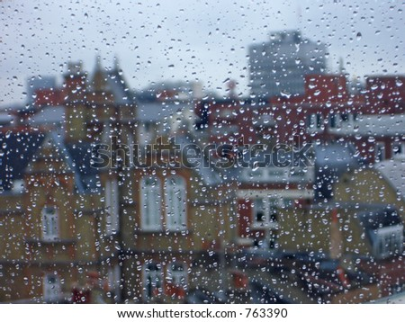 Raindrops decorate a window on a foggy rainy London afternoon. - stock photo