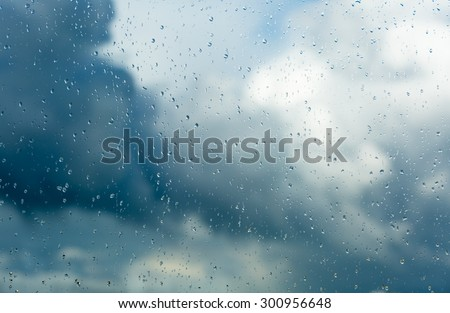 Raindrops on a window during bad, rainy weather.