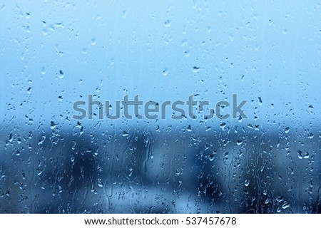 Raindrops on a window glass for rain, in cold tones Photo