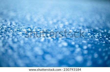Raindrops on blue  metal surface - stock photo